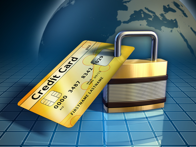 Credit card secured by a metal lock.